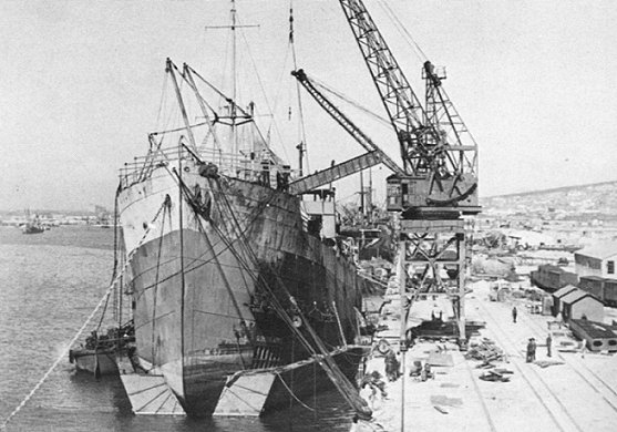 Mangkalihat under repairs in Capetown. Note the pontoon under the bow and the damage to the bow section