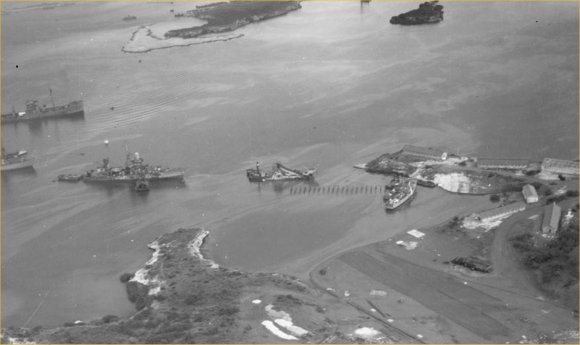 Parera naval base on the left. On the left, the wreck of the sloop USS Erie is brought in. Picture from the National Archives kindly provided by Jon Balson.